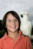 Boy with Cockatoo on His Shoulder