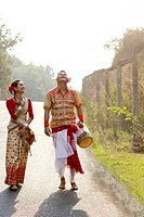 Bihu dancers walking together and laughing