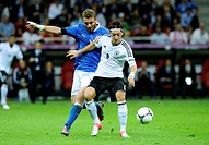 Mesut Ozil, Germany, Daniele De Rossi, Italy, 2012 UEFA European Football Championship, 2nd Semi-final Germany vs. Italy, 1-2, National Stadium, Warsa...