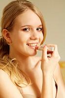 Young teenage girl applying make-up