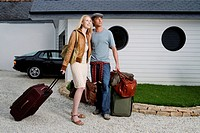 Couple Waiting with Luggage