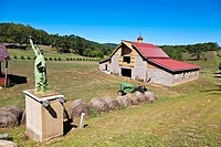 A small replica of the Statue of Liberty on a rural farm near Franklin, South Carolina
