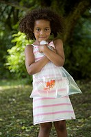 Girl Holding Bag with Goldfish