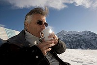 Man Drinking Coffee on Ski Slope