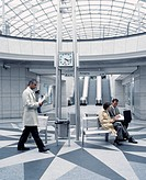 Businesspeople in Modern Transit Station