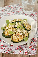 Grilled courgette slice with feta and mint