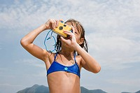 Little Girl Taking a Picture at the Beach