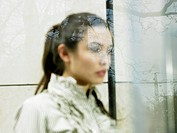 Woman Behind Glass with Reflection