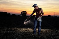 Shirtless Man Planting Seeds