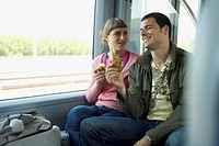 Couple Riding on a Train