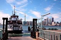 Ferry at a dock with city skyline in the background, Lake Ontario, Toronto, Ontario, Canada