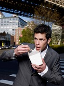 Businessman Eating Takeout Food