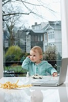 Baby Girl Sitting at Table