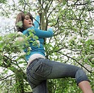 Teenage Girl Climbing at Tree