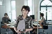 Businesswoman Holding Binder