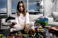 Little Girl Playing with Art Supplies