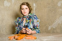 Woman in Floral Blouse Peeling Carrots