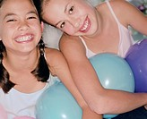 Girls Laughing Holding Balloons