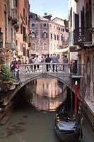 Tourists standing on a bridge crossing a canal, Grand Canal, Venice, Veneto, Italy