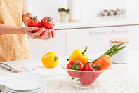Woman Holding Fresh Tomatoes In Kitchen