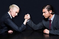 Businesspeople Arm Wrestling