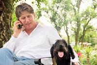 Man talking on phone outdoors
