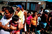 Nicaragua, Managua, Families in line at La Chureca Industrial waste disposal site