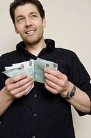 Man Counting Euros