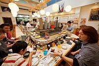 Family at a sushi restaurant, Tsukiji, Tokyo, Japan