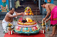 Priest performing Yajna a Hindu ritual outside a temple, Sri Srinivasa Perumal Temple, Little India, Singapore