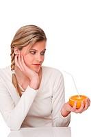 Healthy lifestyle series _ Woman watching orange