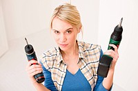 Home improvement _ woman with battery screwdriver