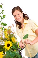 Gardening _ woman with sunflower and pruning shears