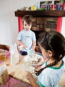 Children prepare cookies in the kitchen