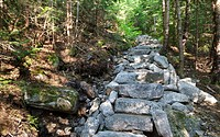 Stone steps along the Mt Tecumseh Trail in the White Mountains, New Hampshire USA The area on the left is in the process of collapsing