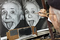 A painter copying a picture of Albert Einstein