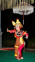 A young girl dancing the Legong, Ubud, Bali, Indonesia    Balinese girls learn traditional dances from a very young age  This performer is just 5 year...