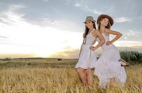 Brunette couple dancing and walk in the countryside