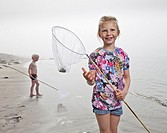 Girl at the beach fishing, Akranes, Iceland