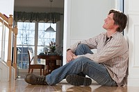 Man sitting on the floor at home