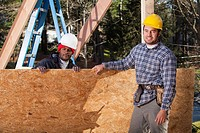 Carpenters with a particle board