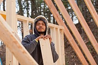 Portrait of a carpenter reviewing work on house construction