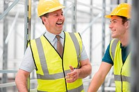 Two men laughing in warehouse