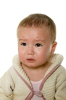 Studio portrait of Asian baby girl crying on white background