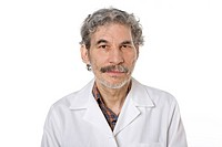 Studio portrait of mature Hispanic male doctor with a mustache looking at the camera on white background