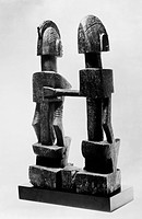 Rear view of a carved wooden sculpture of an embracing couple, made by the Dogon people of Mali, 19th century.