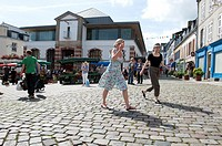 Women walking at the market, douarnenez france
