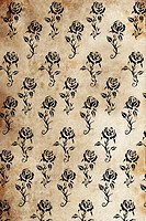 Tattoo pattern with rose designs over antique paper