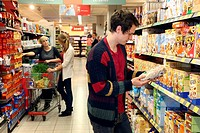 Man buying muesli, food hall, supermarket, Germany, Europe