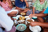 A rural family from Thailand eating their meal